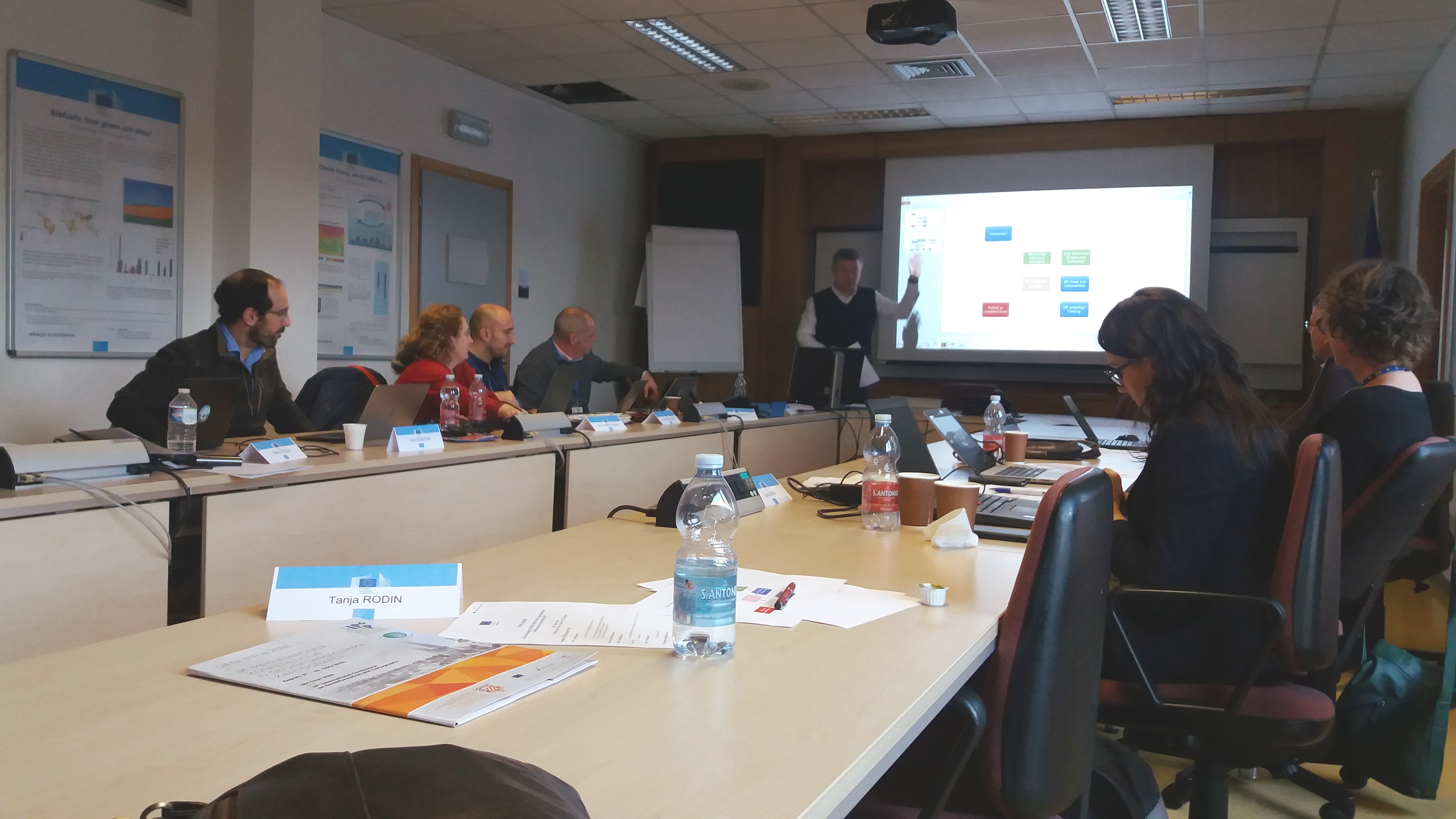 The picture shows the members of the INSPIRE Working Group on Monitoring and Reporting at a working meeting at the Joint Research Center in Ispra, Italy.