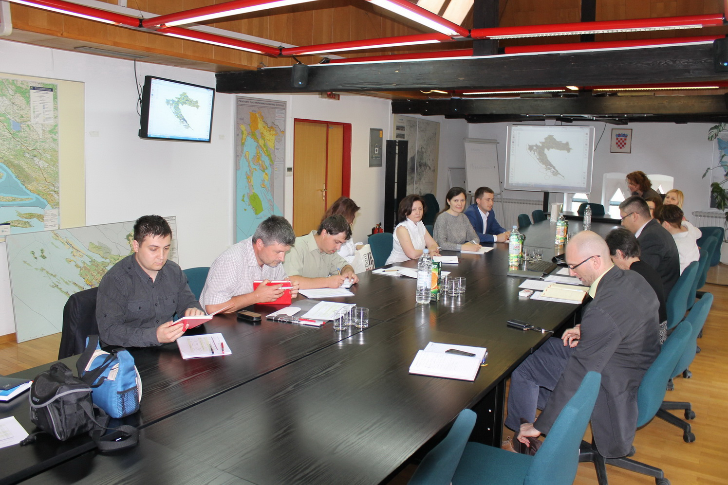 The picture shows the members of the Moldovan delegation visiting one of the institutions that successfully and attractively presented their achievements in the field of NSDI.